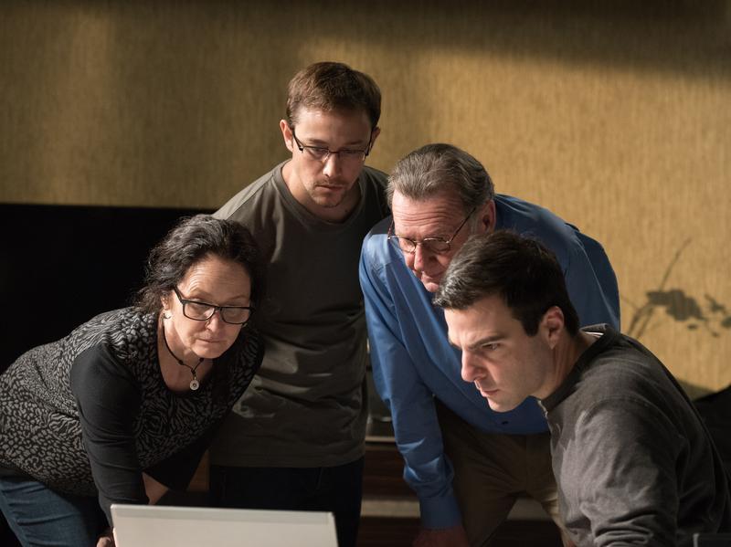 "This image released by Open Road Films shows, from left, Melissa Leo as Laura Poitras, Joseph Gordon-Levitt as Edward Snowden, Tom Wilkinson as Ewen MacAskill and Zachary Quinto as Glenn Greenwald, in a scene from ""Snowden."""