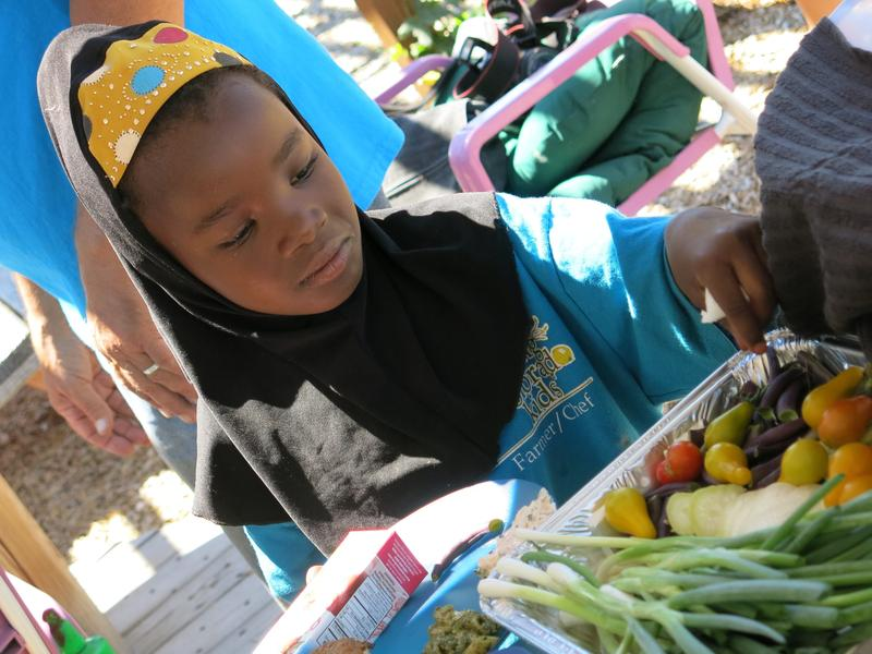 Second-grader Kadija Noor's family came to the U.S. from Somalia. She says being a part of Growing Colorado Kids has led her to eat more healthful foods, although she still prefers the garden's strawberries to its vegetables.