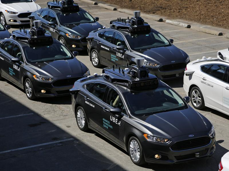 Self-driving Uber vehicles are lined up to take journalists on rides during a media preview at the company's Advanced Technologies Center in Pittsburgh earlier this month.
