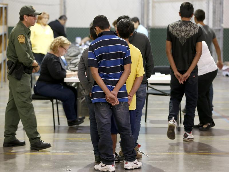 Central American immigrant children are processed at the U.S. Customs and Border Protection officials in Nogales, Ariz.
