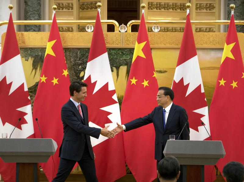 Canadian Prime Minister Justin Trudeau (left) and China's Premier Li Keqiang wrap up a joint press conference in Beijing on Aug. 31. Canada and China have agreed to discuss the possibility of an extradition treaty.