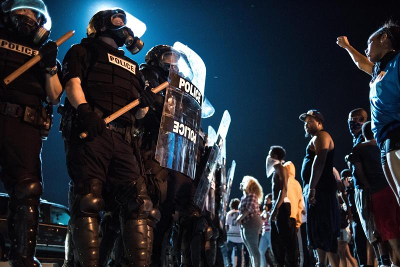 Police officers face off with protesters on the I-85 during protests following the death of a black man, 43-year-old Keith Lamont Scott, shot by a black police officer on Sept. 21, 2016 in Charlotte, N.C. (Sean Rayford/Getty Images)