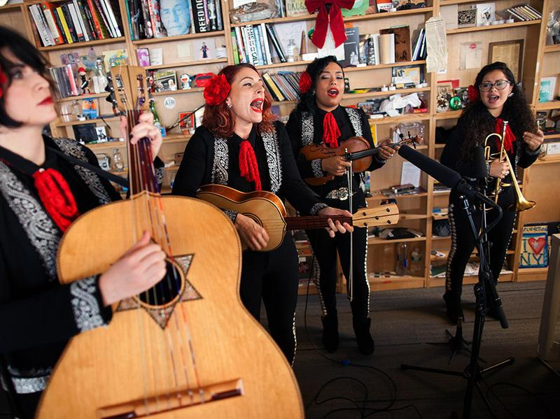 Mariachi Flor De Toloache is just one of the many Latin bands who have graced NPR's Tiny Desk.