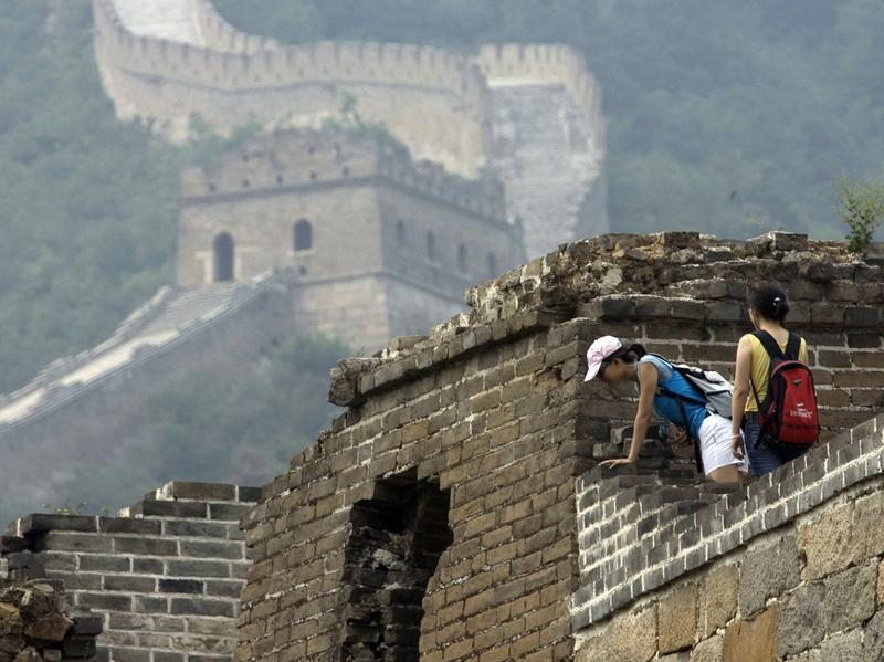 Chinese teens try to find their way through a rugged section of the Great Wall of China in Beijing in 2007.