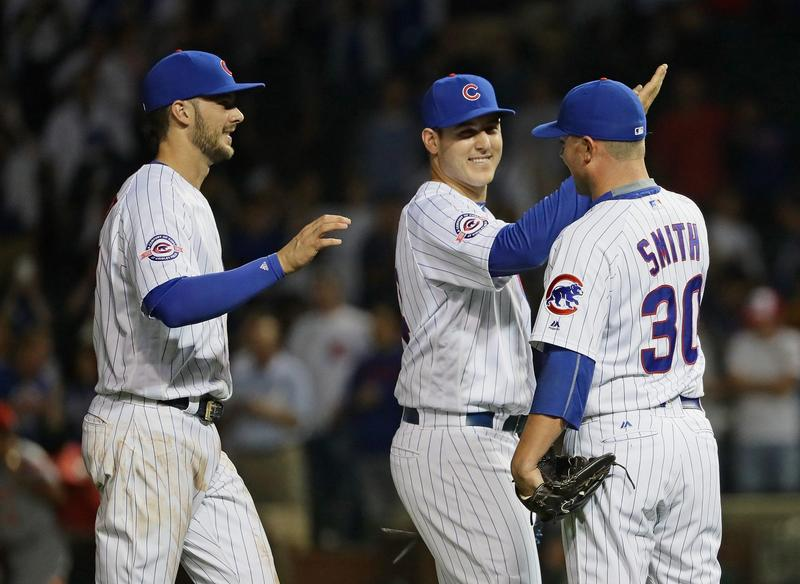 Kris Bryant (left), Anthony Rizzo (middle) and Joe Smith of the Chicago Cubs celebrate a win over the Cincinnati Reds at Wrigley Field on Sept. 21, 2016, in Chicago. (Jonathan Daniel/Getty Images)