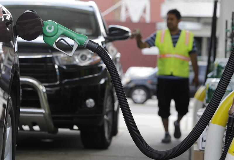 A nozzle pumps gas into a vehicle at a BP gas station, Thursday, June 30, 2016, in Hoboken, N.J. Switching to a car with better fuel economy is one way individuals can combat climate change, according to author and climate scientist Brenda Ekwurzel. (Julio Cortez/AP)