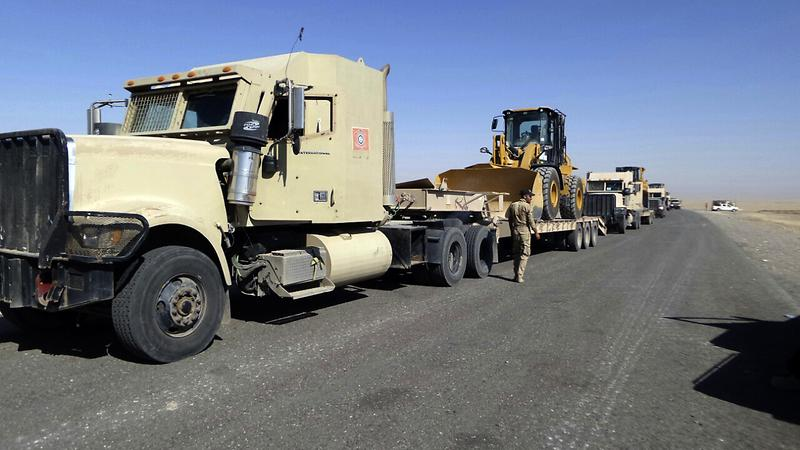 Iraqi security forces are stationed outside the city of Shirqat near Mosul, Iraq, Tuesday, Sept. 20, 2016. Iraqi forces have launched a new military operation to recapture a key town north of Baghdad from the Islamic State group. (AP)