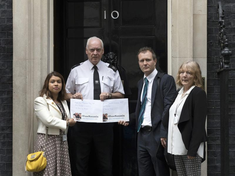 Richard Ratcliffe, second from right, delivers a petition to the British prime minister's official residence calling on Iran to release his wife, Nazanin Zaghari-Ratcliffe. She was stopped in April at the airport in Tehran with the couple's 2-year-old daughter as they tried to return to Britain after a family holiday. Ratcliffe was at the United Nations this week appealing for their release.