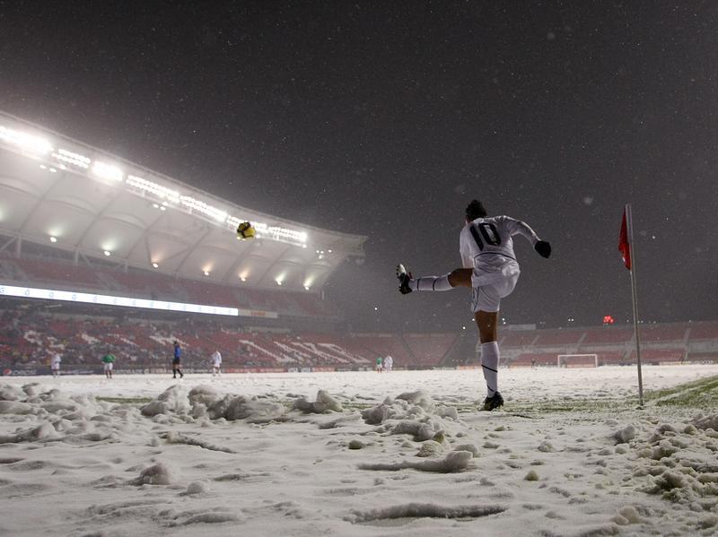 Carli Lloyd takes a corner kick during a 2010 international friendly match between the U.S. and Mexico in Sandy, Utah.