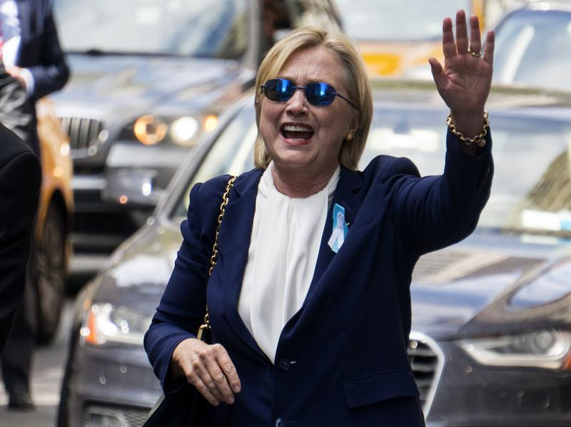 Democratic presidential candidate Hillary Clinton waves as she walks from her daughter's apartment building Sept. 11, 2016, in New York. Clinton unexpectedly left the 9/11 anniversary ceremony. Her campaign later announced she had been diagnosed with pneumonia.
