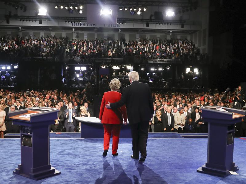 Presidential candidates Hillary Clinton and Donald Trump acknowledge their debate audience Monday night at Hofstra University. Tens of millions more were watching in audiences gathered elsewhere.