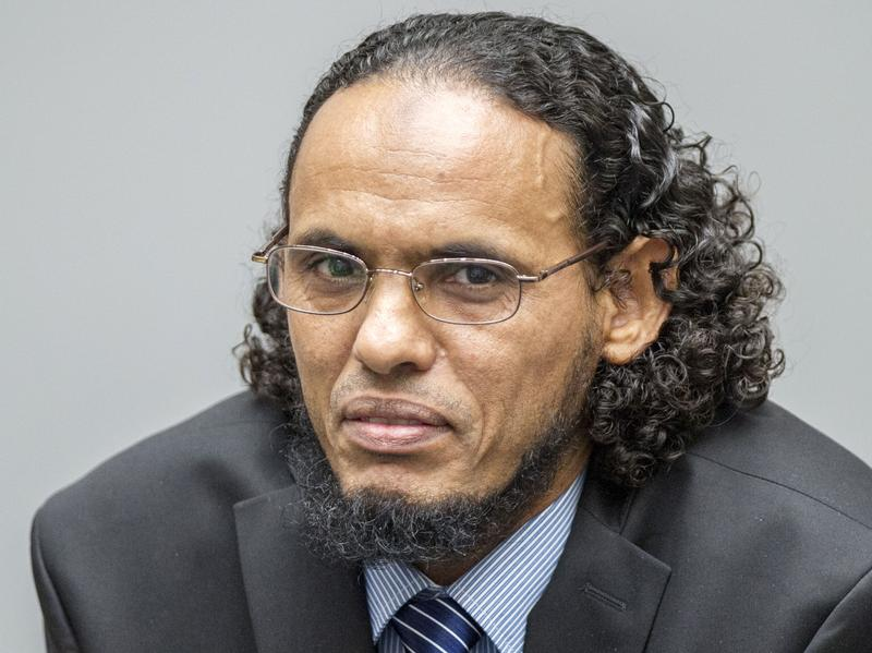 Ahmad al-Faqi al-Mahdi looks on during an appearance at the International Criminal Court in The Hague, Netherlands, on Aug. 22, at the start of his trial on charges of involvement in the destruction of historic mausoleums in the Malian desert city of Timbuktu. Mahdi pleaded guilty.
