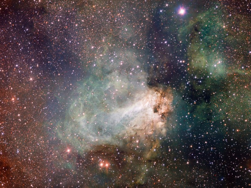 The star-forming area Messier 17, also known as the Omega Nebula or the Swan Nebula, is a vast region of gas, dust and hot young stars that lies in the heart of the Milky Way in the constellation of Sagittarius.