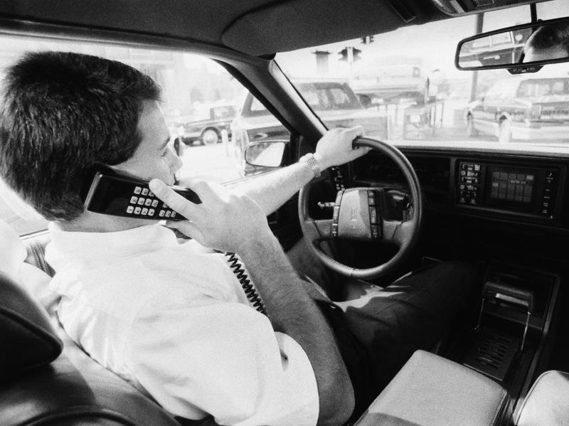 "The original caption to this 1989 photo read, ""Cellular phones are being offered by many car manufacturers as optional equipment for drivers who can't bear to be out of touch, even on the road."""