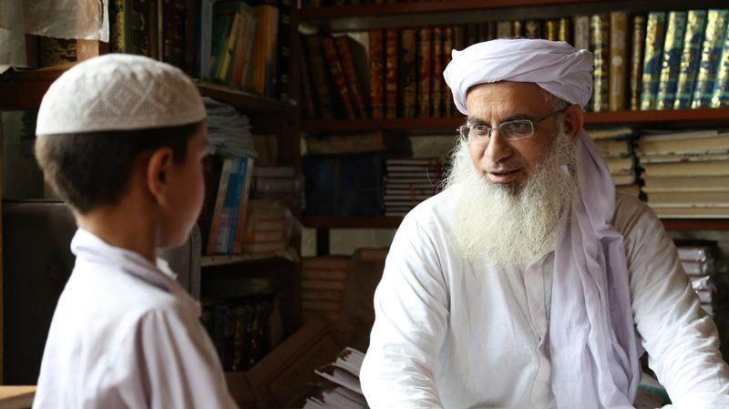 "Pakistani cleric Abdul Aziz Ghazi (right), in a still frame from the documentary ""Among the Believers."" (Courtesy)"