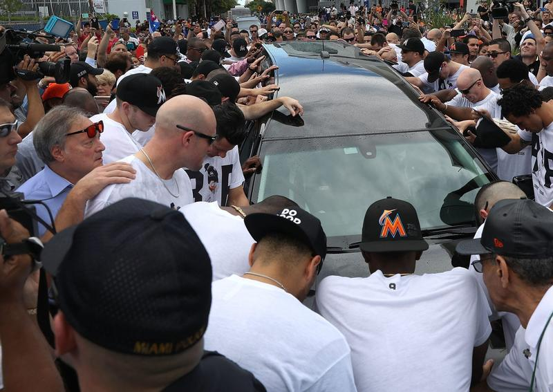 Miami Marlins owner,  Jeffrey Loria (L), along with players and other members of the Marlins organization and their fans, gather next to the hearse carrying Marlins pitcher Jose Fernandez to pay their respects as they pass in front of Marlins Park on Sept. 28, 2016, in Miami. (Joe Raedle/Getty Images)