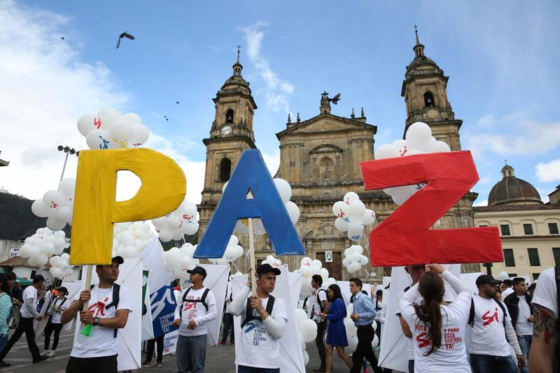 "People hold up letters that form the word ""Peace"" in Spanish during a gathering at Bolivar square in Bogota, Colombia, Monday, Sept. 26, 2016. (Jennifer Alarcon/AP)"