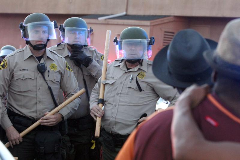 Protesters face off with police during a rally in El Cajon, a suburb of San Diego, Calif. on Sept. 28, 2016. (Bill Wechter/AFP/Getty Images)