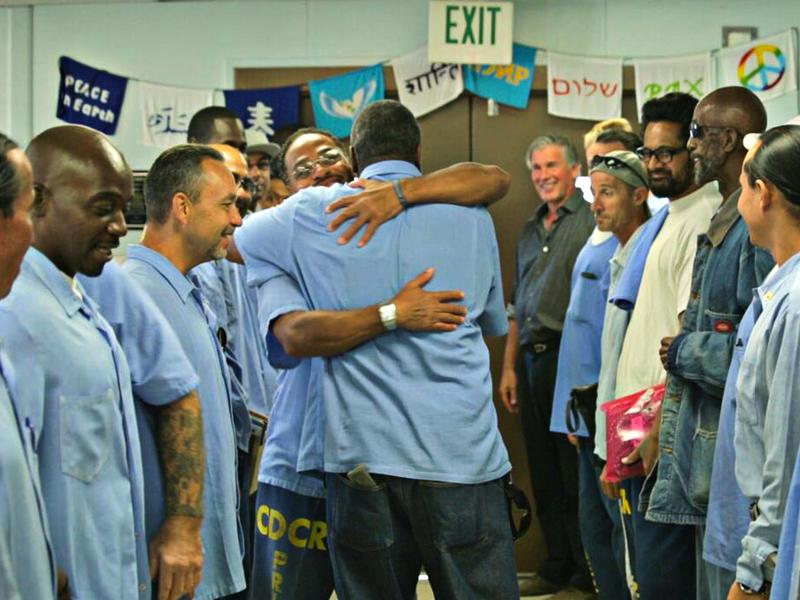Participants in Project GRIP celebrate one man's release. Through the yearlong course, prisoners are taught how to confront and deal with what got them into prison in the first place.