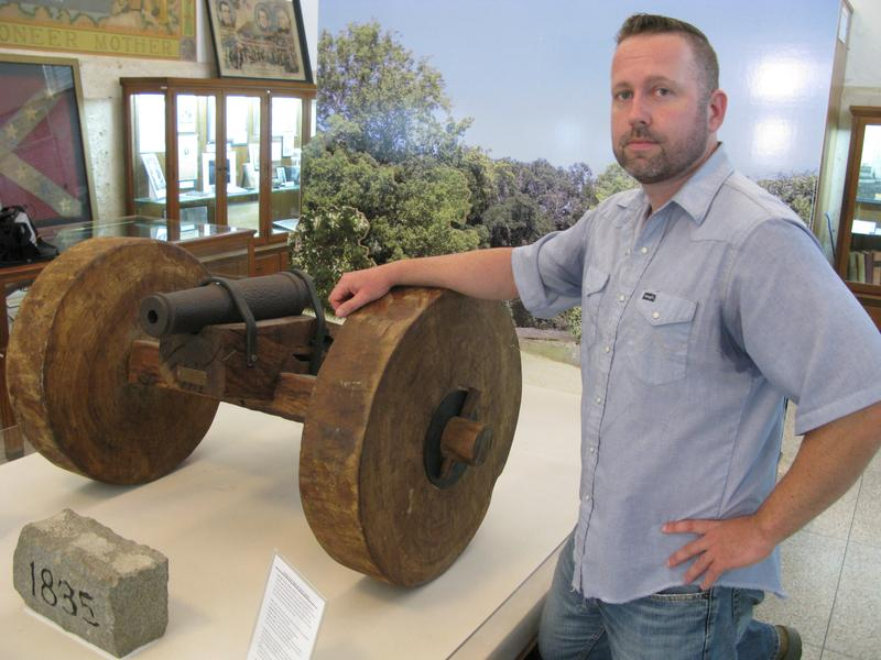 """Local journalist Erik McCowan, standing in the Gonzales Memorial Museum, thinks people should know the history behind the phrase, """"Come and take it!"""""""