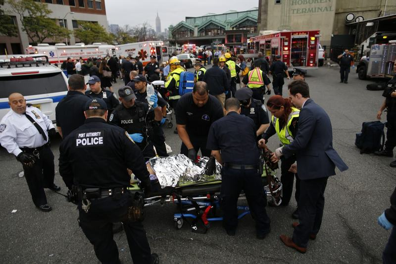 First responders treat injured passengers after a New Jersey Transit train crashed into the platform at Hoboken Terminal during morning rush hour on Sept. 29, 2016 in Hoboken, New Jersey. (Eduardo Munoz Alvarez/Getty Images)