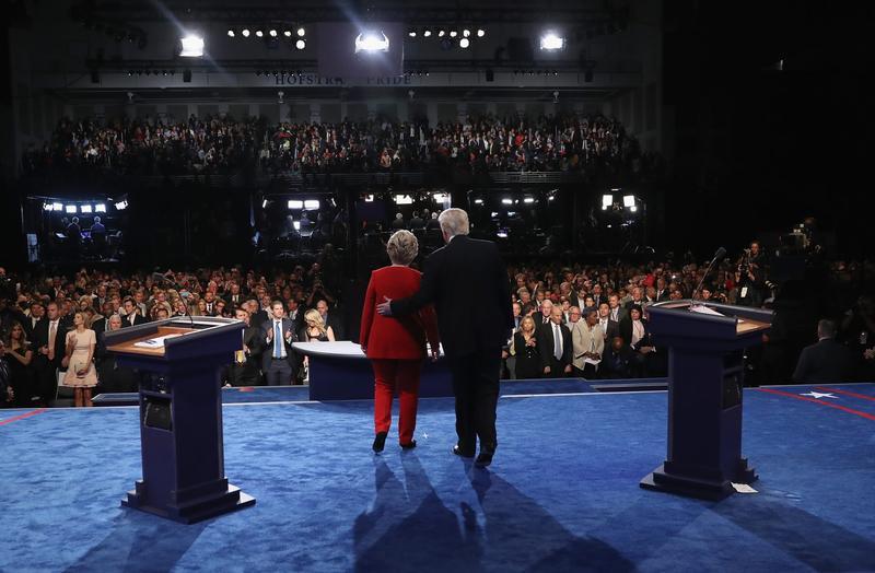 Republican presidential nominee Donald Trump (R) and Democratic presidential nominee Hillary Clinton (L) shake hands after the presidential debate at Hofstra University on Sept. 26, 2016 in Hempstead, N.Y. (Joe Raedle/Getty Images)