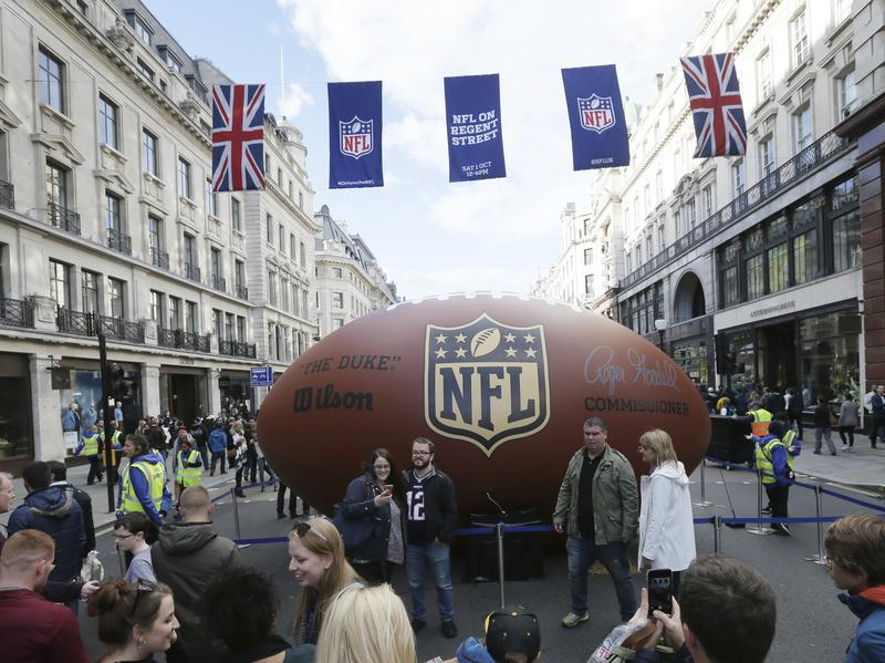 People pose for pictures during an NFL fan rally on Regent Street in London on Saturday.