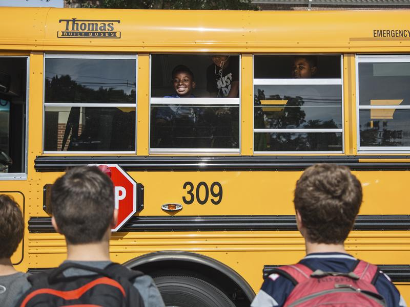 Oak Hill Middle School students say goodbye to METCO students heading back to Boston on the bus.