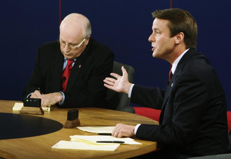 Vice President Dick Cheney takes notes as Democratic vice presidential candidate Sen. John Edwards speaks during their vice presidential debate at Case Western Reserve University in Cleveland  on Tuesday, Oct. 5, 2004. (Rick Wilking/AP)
