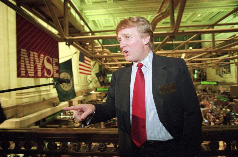 This June 7, 1995, file photo shows real estate magnate Donald Trump posing for photos above the floor of the New York Stock Exchange after taking his flagship Trump Plaza Casino public in New York City. Trump's business losses in 1995 were so large that they could have allowed him to avoid paying federal income taxes for as many as 18 years, according to records obtained by The New York Times. (Kathy Willens/AP)