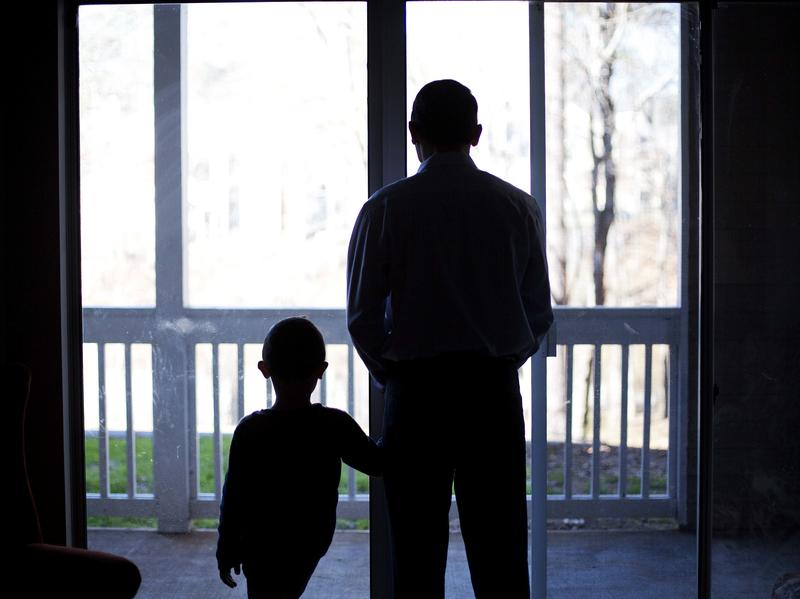 A Syrian refugee poses with his son in their home in Marietta, Ga., earlier this year.