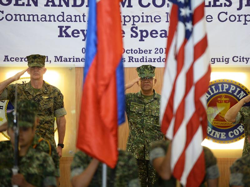 U.S. Marines Brig. Gen. John Jansen (left), Philippines marines Maj. Gen. Andre Costales (center) and Brig. Gen. Maximo Ballesteros salute during the opening ceremony of the Amphibious Landing Exercise in Manila on Tuesday. The Philippines and the U.S. launched war games on October 4 against the backdrop of the unusual threat of U.S. forces being ejected from the Southeast Asian nation.