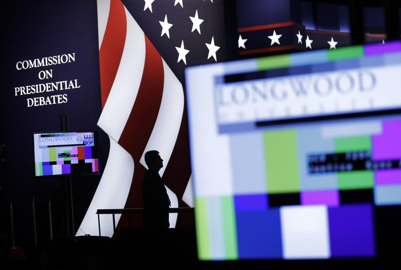 An official stands on stage during preparations for the vice-presidential debate between Republican vice-presidential nominee Gov. Mike Pence and Democratic vice-presidential nominee Sen. Tim Kaine at Longwood University in Farmville, Va., Monday, Oct. 3, 2016. (Patrick Semansky/AP)