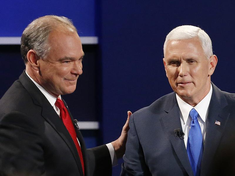 Democratic Sen. Tim Kaine and Republican Gov. Mike Pence shake hands after the vice presidential debate at Longwood University in Farmville, Va., on Tuesday.