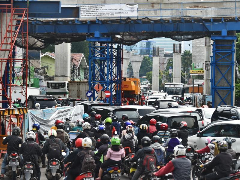 Motorists in Jakarta — like these seen in a file photo from February — saw several minutes of an adult video last Friday, after a large video billboard was taken over in an apparent prank.