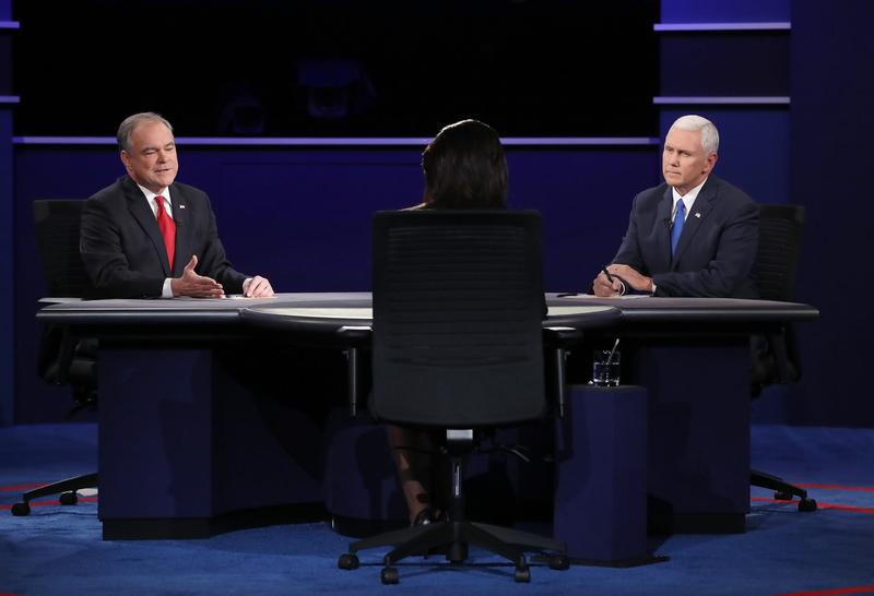 Democratic vice presidential nominee Tim Kaine (left) speaks as Republican vice presidential nominee Mike Pence (right) and debate moderator Elaine Quijano (center) listen during the vice-presidential debate at Longwood University on Oct. 4, 2016 in Farmville, Va. (Mark Wilson/Getty Images)