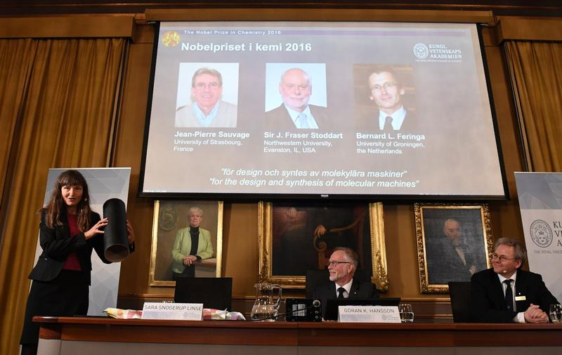 Winners of the 2016 Nobel Prize in chemistry (top, left to right) Jean-Pierre Sauvage, J. Fraser Stoddart and Bernard L. Feringa, are seen on display during the official announcement of the prize winners at the Royal Swedish Academy of Sciences in Stockholm on Oct. 5, 2016. (Jonathan Nackstrand/AFP/Getty Images)