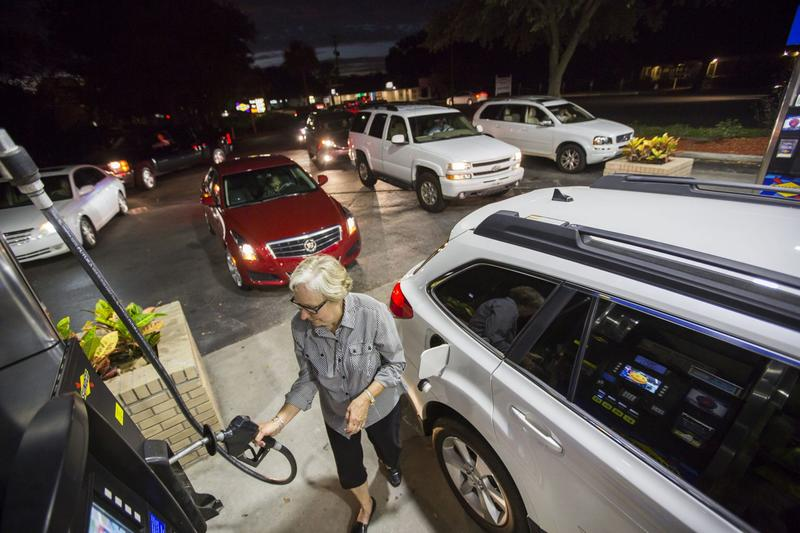Gayle Brown fills up her car after waiting in line at a Sunoco gas station in Mt. Pleasant, S.C., Tuesday, Oct. 4, 2016 in advance of Hurricane Matthew. (Mic Smith/AP)
