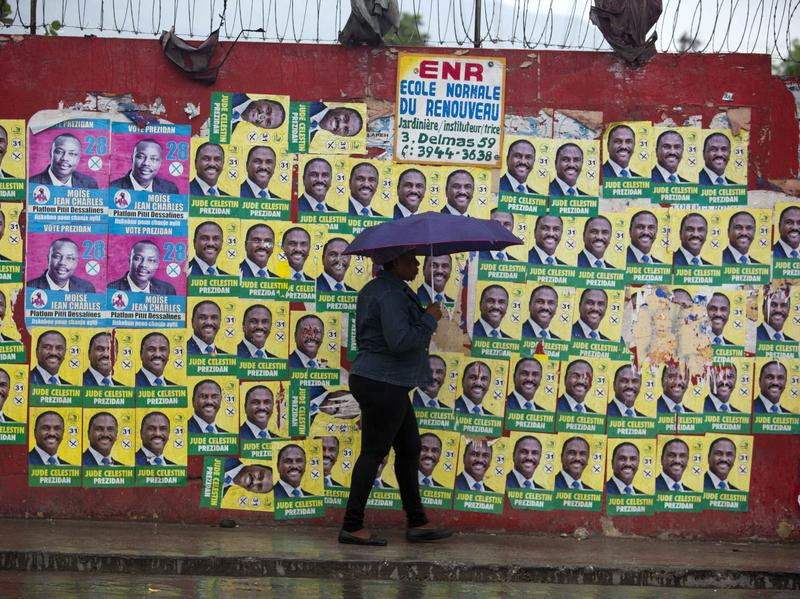 A wall blanketed with presidential campaign posters, in Port-au-Prince, Haiti, on Monday. The long-delayed election, scheduled for Sunday, has been put off again after Hurricane Matthew devastated much of the country.