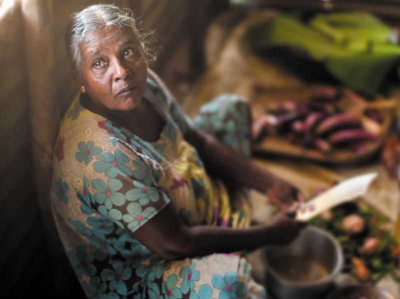 After losing her daughter during the war, Vijaya cares for her granddaughter Anjali. Despite not being able to afford fresh vegetables, she cooks nourishing sothis or stews made of coconut milk.