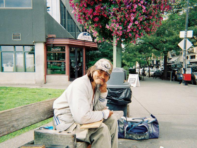 In a photo taken just hours before his death, John T. Williams sits at Victor Steinbrueck Park in Seattle. Williams would carve here regularly.