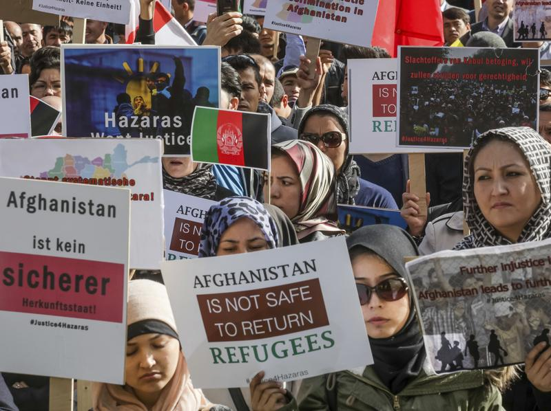 People who belong to Afghanistan's Hazara minority demonstrate outside the venue of a conference on Afghanistan in Brussels on Wednesday.