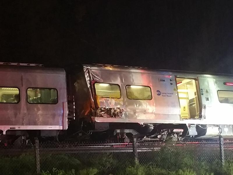 A photo provided by Sarah Qamar shows a Long Island Railroad train derailed near New Hyde Park, N.Y., Saturday. The commuter train hit a work train on the tracks.