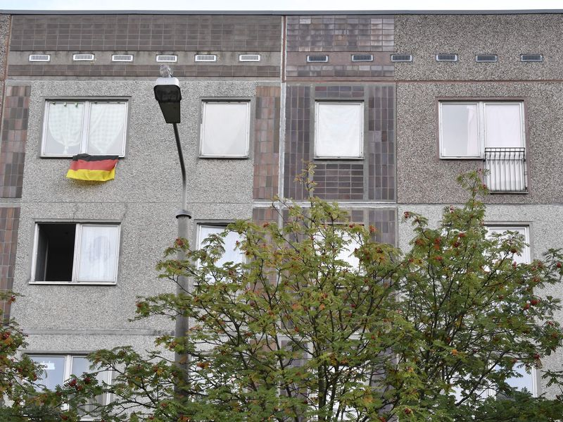 The apartment (upper right) in a communist-era housing block in Leipzig, a city in eastern Germany is the location where a Syrian man, suspected of plotting a jihadist bomb attack, was arrested on Monday. After a nationwide manhunt, the man was caught by fellow Syrian refugees. The case has sparked fresh calls for greater checks on asylum seekers.