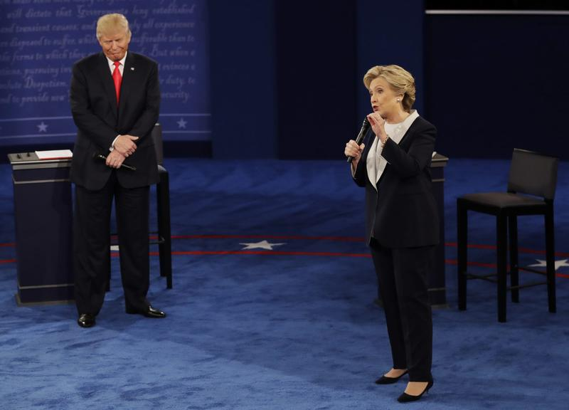 Republican presidential nominee Donald Trump listens to Democratic presidential nominee Hillary Clinton during the second presidential debate at Washington University in St. Louis, Sunday, Oct. 9, 2016. (Patrick Semansky/AP)