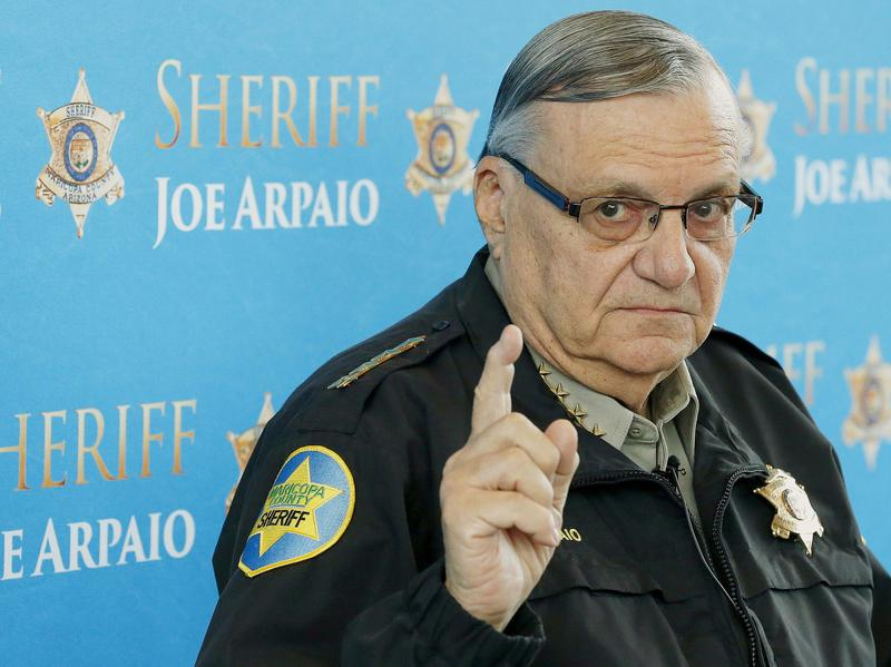 Maricopa County Sheriff Joe Arpaio speaks at a 2013 news conference in Phoenix. Arpaio faces contempt-of-court charges in a racial-profiling case. A federal judge found that Arpaio and his deputies continued conducting immigration patrols after a court ordered them to stop.