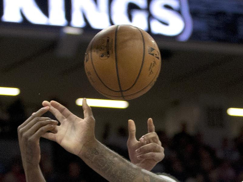 Players battle for the ball during an NBA exhibition game between the Sacramento Kings and Israel's Maccabi Haifa on Monday in Sacramento, Calif.