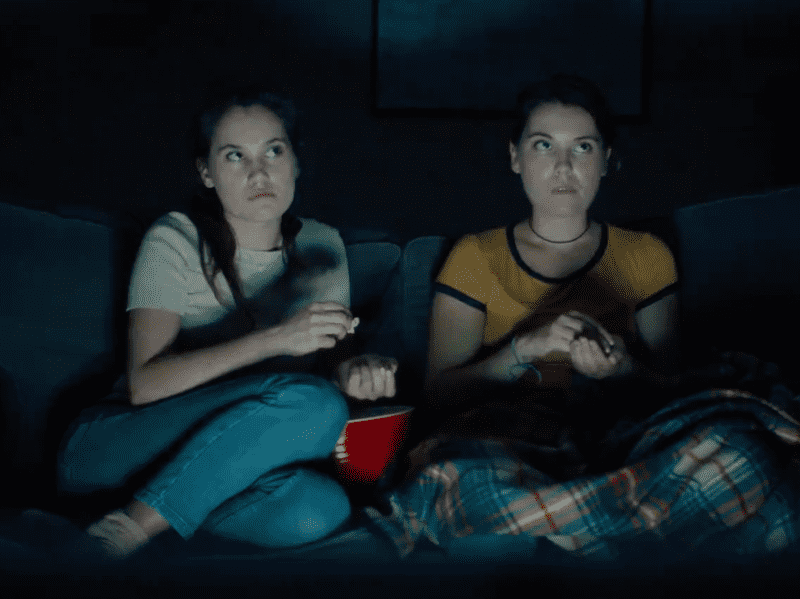 "Lily & Madeleine hear strange noises in the night, in a scene from their new video for the song ""Westfield."""