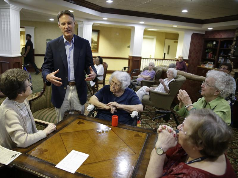 Senate candidate Evan Byah talks with seniors at a living community in Indianapolis. Voters who support both Donald Trump and Bayh in red Indiana have to, at some level, hold two conflicting ideas simultaneously €-- a desire for change and an appreciation for a politician's past record.