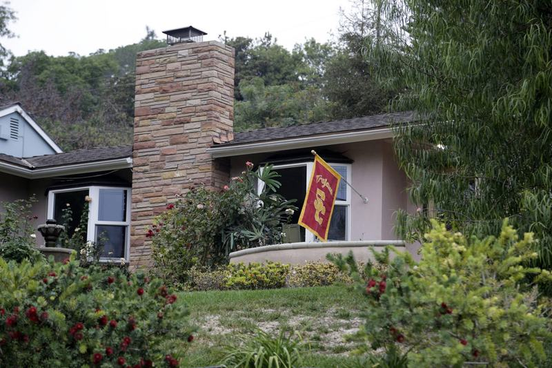The Whittier, Calif., home where Los Angeles Police Detective Nadine Hernandez was found with a gunshot wound Tuesday, Oct. 12, 2016, is seen Wednesday. She died later Tuesday at a hospital. (Nick Ut/AP)